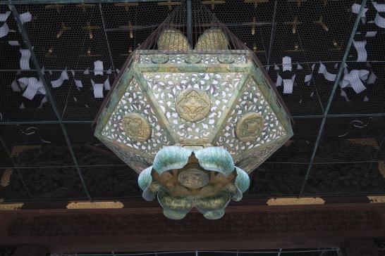 Oxidized lantern at hte entrance