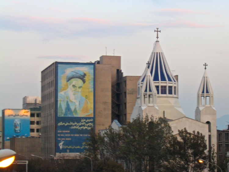 The Ayatollah Khomeini stares down at Sarkiss Cathedral, a spectacular Armenian church in Tehran. There are about 250,000 Armenian Christians in Iran.