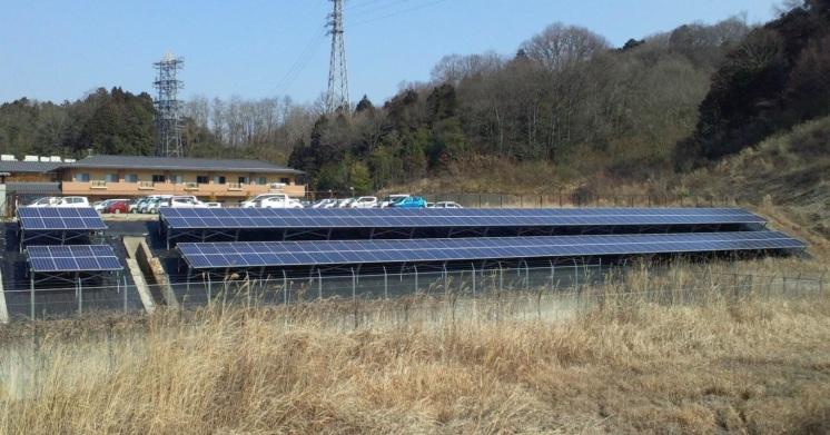 Solar panels on a bank behind a seniors facility.