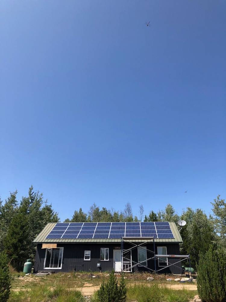 building with solar panels on roof