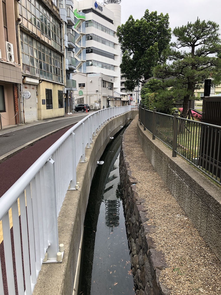 "Dejima on the right. A curved and narrow strip of water preserves its ""islandness."""
