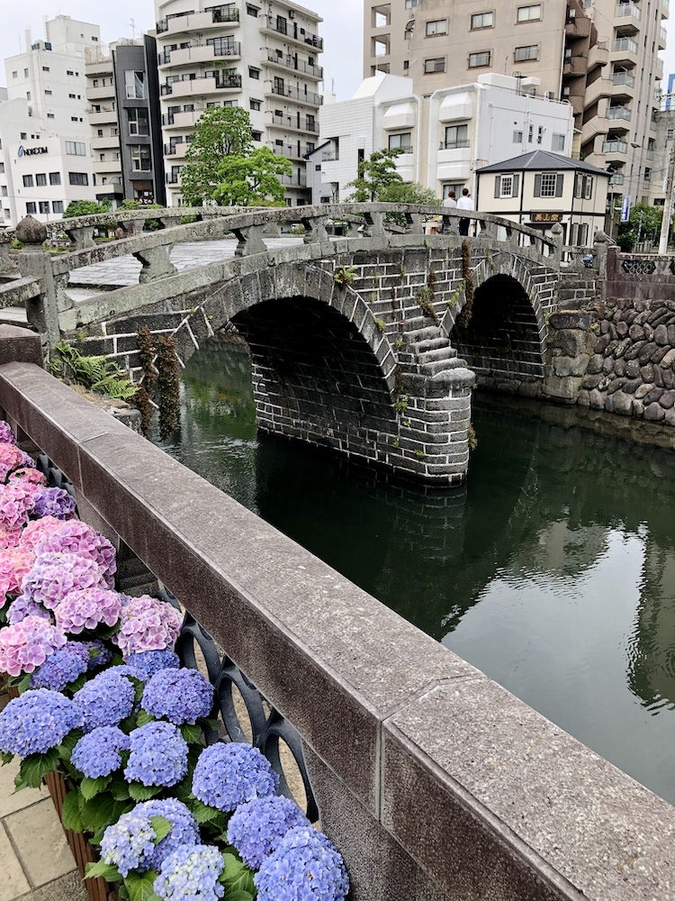 Photo of Meganebashi with azaleas in the foreground