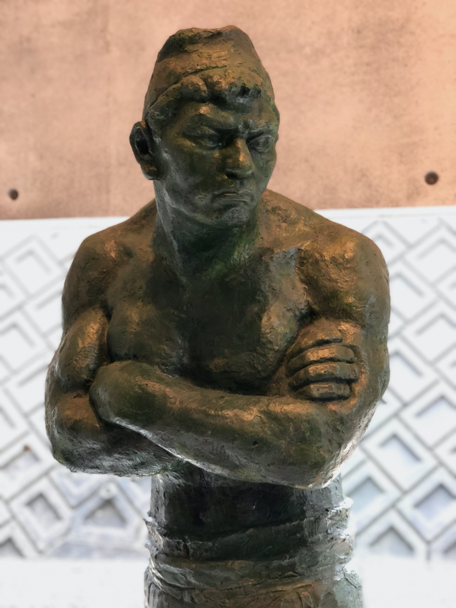 Statue of muscular man with angry face