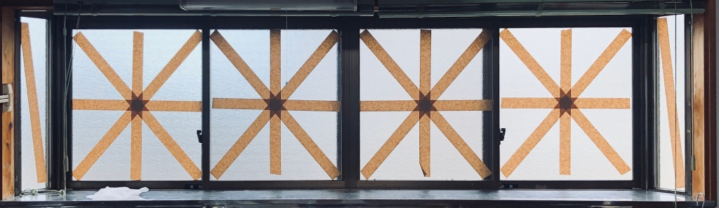 series of taped windows