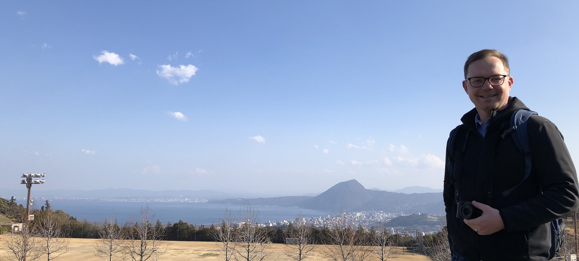 Chad poses in front of vista of Beppu bay